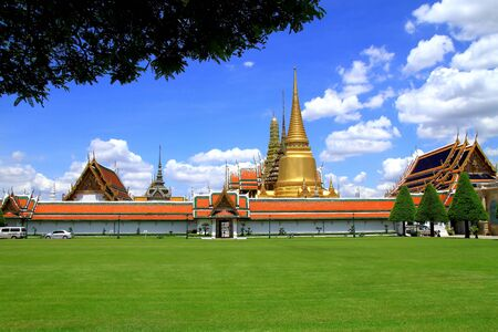 Monastery and grass park at Wat Phra Kaew in Bangkok, Thailand photo