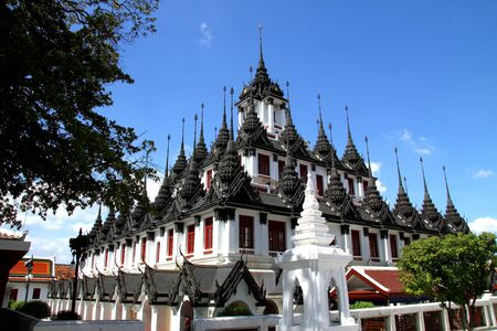 photons: Architectue that is metallic castle and blue sky at Wat Rachanutda in Bangkok, Thailand. Stock Photo