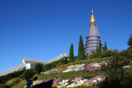 Blue sky at Park Nation Inthanon with pagoda and flower on county Chiang Mai, of Thailand photo