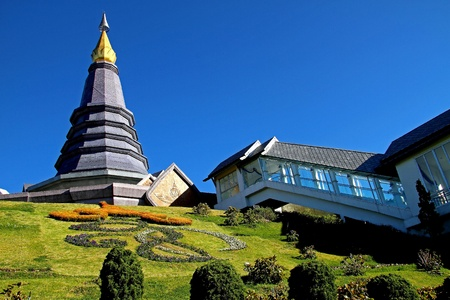 Blue sky with pagoda and sculpture at Doi Inthanon top mountai on county Chian Mai, of Thailand photo