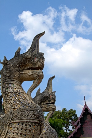 Two bird creatures sculpture looking cloud and sky at Jadee Loung temple in Chiangmai Thailand  photo