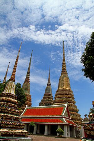 Sharp Pagoda at Wat Pho temple with more cloud in Bangkok, Thailand   photo