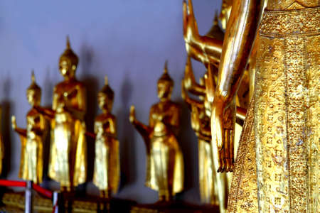Hand buddha golden statue blessing at Wat Pho temple, Bangkok, Thailand  photo
