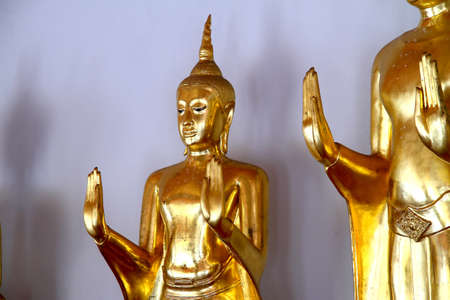 Statue buddha action blessing with hand at Wat Pho temple, Bangkok, Thailand  photo