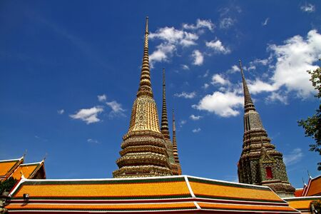 Small white cloud and blue sky at Wat Pho temple with in Bangkok, Thailand   photo