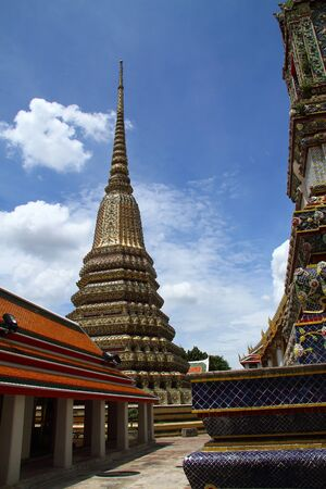 Sharp architecture wiiht day much cloud at Wat Pho temple with in Bangkok, Thailand  photo