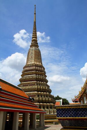 Sky the day much cloud  and sharp pagoda at Wat Pho temple with in Bangkok, Thailand  photo