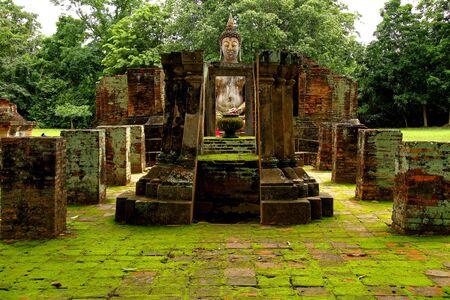 Old statue buddha and algae at Wat Si Chum in Sukhothai Historical park, Thailand  photo