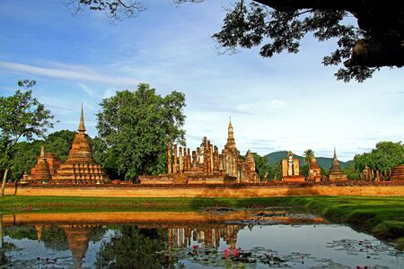 Basin with sky and architecture of Wat Pra Mahathat in Sukhothai Historical park, Thailand  photo