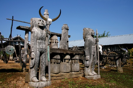 thialand: Old image redskin carve made wood and blue sky at country of Thialand.