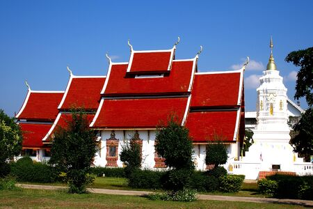Bright blue sky and red church at Wat Sree Bunyoun Nan Province, Thailand photo