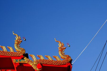 Idyllic of stature dragon whit  blue sky at Wat  Don Keaw  Nan Province, Thailand photo