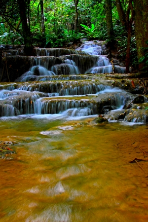 Small waterfall and rainforest and in National park Lumphang county of, Thailand  photo