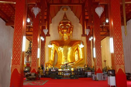 Gold big sculpture Buddha in Temple Sri Kom Kam, Phayao Province, Thailand  It is open daily