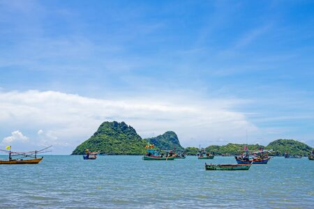Beautiful blue sky with cloud and thai fishing boat at island, of beach Thailad  photo