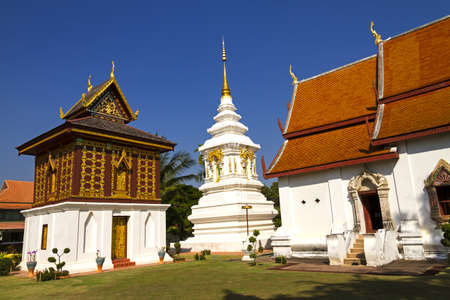 Outdoor church and white pagoda at Wat Hua Kuang, Nan,Thailand  photo