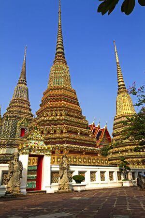 Three  sharp pagoda with blue sky at Wat Pho temple in Bangkok,Thailand  photo