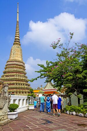 Travel  and  sharp pagoda with blue sky at Wat Pho temple in Bangkok,Thailand  photo