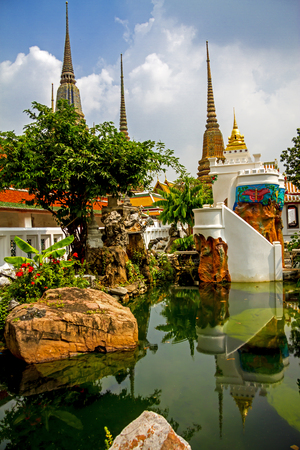 Sharp architecture side the pool at Wat Pho temple in Bangkok,Thailand  photo