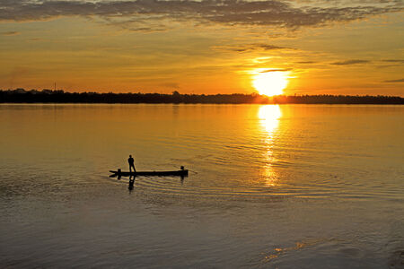 river county: The man and small boat with sunrise at  Mekong River, Mukdahan county,Thailand