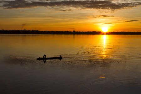river county: Small fishing boat and sunrise at  Mekong River, Mukdahan county,Thailand