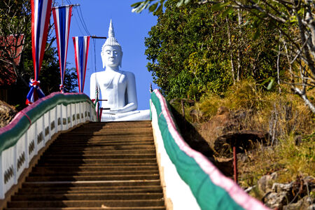 godhead: White  buddha sit on stair whit blue sky at  Khon Kaen country Thailand
