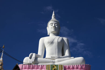 Big white statue buddha sit with blue sky at  Khon Kaen country Thailand  photo