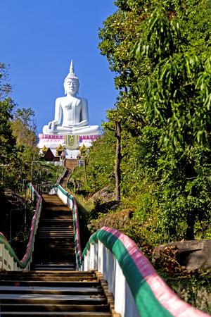 godhead: Pathway to white  buddha  whit blue sky at  Khon Kaen country Thailand Stock Photo