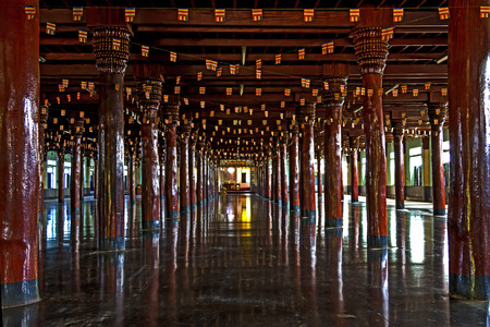 sou: Wooden pole roud  inside hall  is made from teak,Wat Sou Phun Ton, In  Myanmar Stock Photo