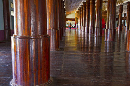 Wooden pole row round  is made from teak,Wat Sou Phun Ton, In  Myanmar