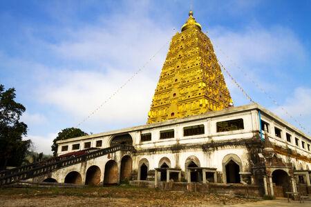 banian: Golden Bodh Gaya pagoda with ctloud in district Sangkhlaburi, Kanchanaburi country of Thailand