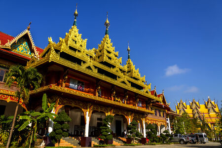 banian: Golden architecture with sky in district Sangkhlaburi, Kanchanaburi country of Thailand