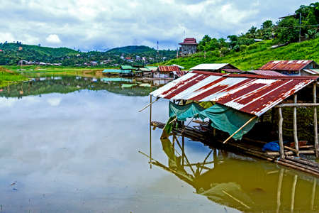 Old hut on lake after rains at sangklaburi, kanchanaburi, Province Asia thailand photo