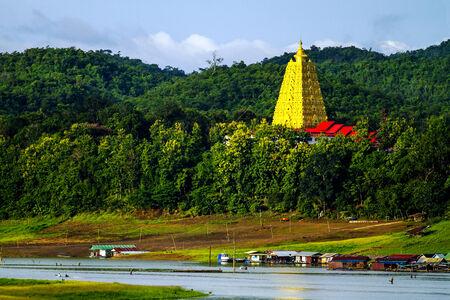 Gold architecture on green forest  at sangklaburi, kanchanaburi, Province Asia thailand photo