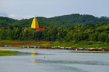 rains: Gold architecture on lake forest  at sangklaburi, kanchanaburi, Province Asia thailand