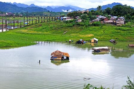 Small  hut on river at sangklaburi, kanchanaburi, Province Asia thailand photo