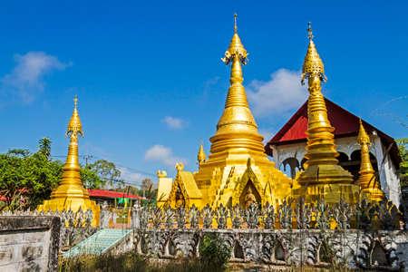 sangkhla buri: Architecture and blue sky at Wat Som Det Temple, Sangkhla Buri, Kanchanaburi Province , Thailand Stock Photo