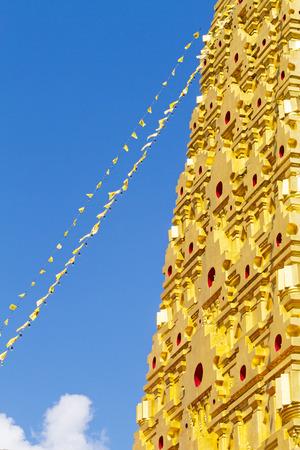 Golden stupa and blue sky at Wangvivagegaram Temple, Sangkhla Buri, Kanchanaburi Province , Thailand