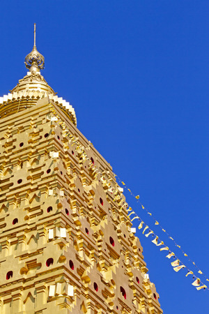 sangkhla buri: Sharp golen and blue sky at Wangvivagegaram Temple, Sangkhla Buri, Kanchanaburi Province , Thailand