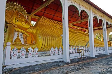 sangkhla buri: Stature big buddha sleep at Wat Som Det Temple, Sangkhla Buri, Kanchanaburi Province , Thailand Stock Photo