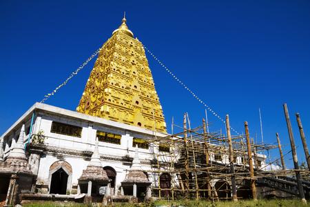 sangkhla buri: Bodhgaya pagoda gold and sky at Wangvivagegaram Temple, Sangkhla Buri, Kanchanaburi Province , Thailand