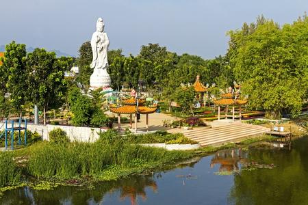 quan yin: Stature white marble Quan Yin stand near The Bridge of the River Kwai Kanchanaburi, Thailand