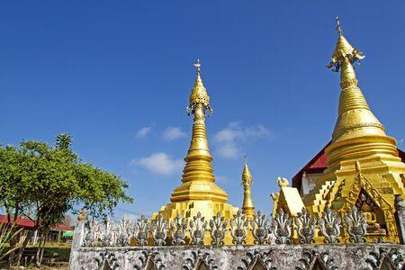 det: Architecture gilded and blue sky at Wat Som Det Temple, Sangkhla Buri, Kanchanaburi Province , Thailand