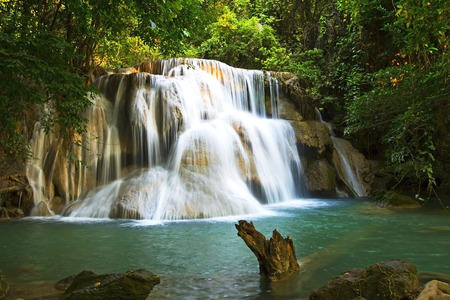 kamin: Waterfall emerald sunlight of Hui Mae Kamin Waterfall, Kanchanaburi, Thailand Stock Photo
