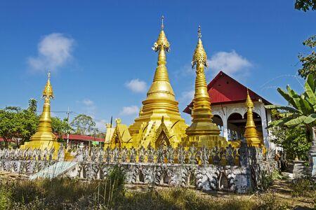 det: Old architecture and sharp pagoda at Wat Som Det Temple, Sangkhla Buri, Kanchanaburi Province , Thailand