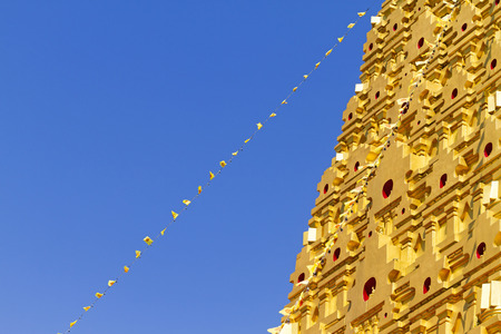 sangkhla buri: Stupa gold and blue sky at Wangvivagegaram Temple, Sangkhla Buri, Kanchanaburi Province , Thailand