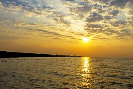 pu: Sunrise golden morning on beach at Bang Pu Seaside of Thailand Stock Photo