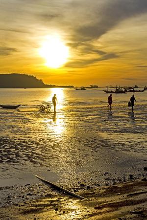 ra: Fisherman silhouette with sunrise on Pha Ra Don Phap beach at Chumphon Provice, Thailand
