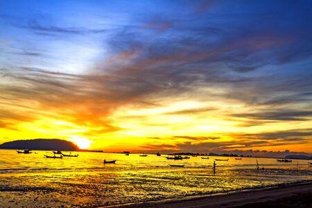 folkways: Morning sunrise and folkways on Pha Ra Don Phap beach at Chumphon Provice, Thailand