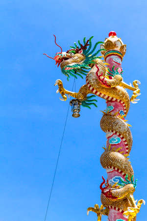 minutiae: Statue dragon beautiful on pole with blue sky background in province, Thailand